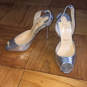 NWT Silver louboutin evening sandals.